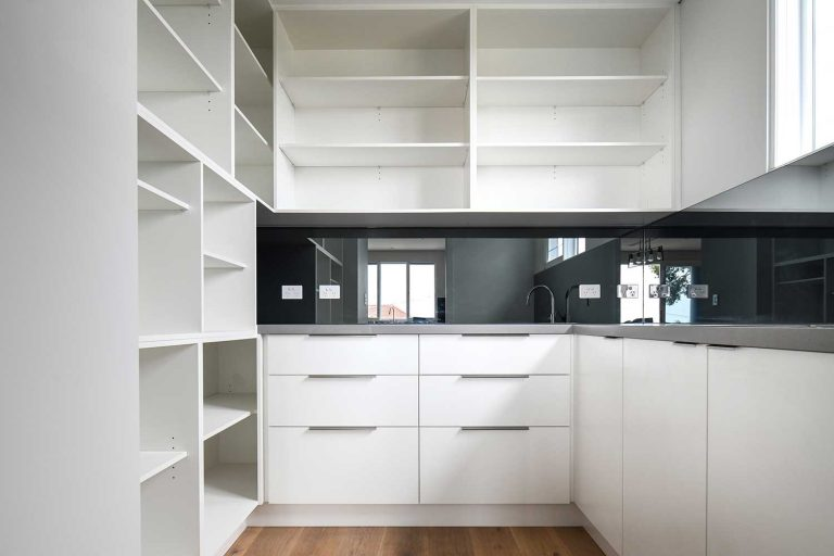 A beautiful new polyurethane kitchen features a large butler's pantry.