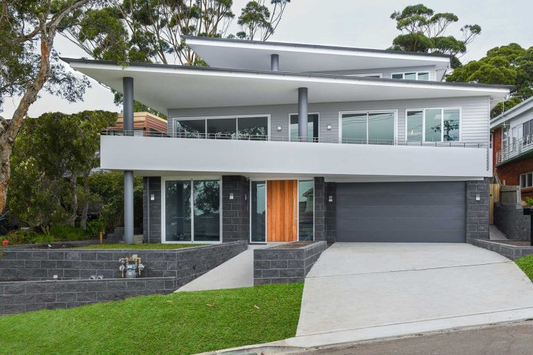 This new home in Beacon Hill features a variety of external wall systems: Sycon profile cladding, brick render and poly render band.