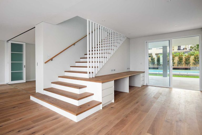 A feature staircase leads from the middle level to the upper level bedrooms in this new Beacon Hill home.