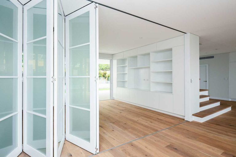 Large bi-fold doors are a feature of the mid-level living area in this new Beacon Hill home.