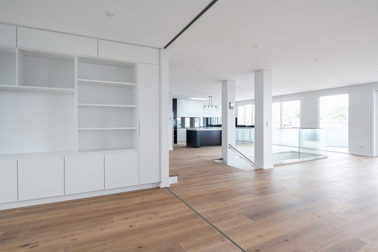 The multiple living areas feature built-in joinery with extensive storage.