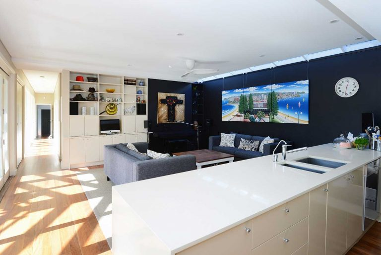 The lounge and kitchen area in the extension of a Manly residence built by Diamond and Lambert Builders.
