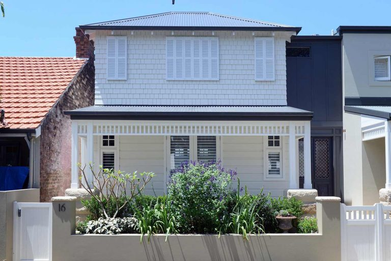 External walls are double brick render and weatherboard; shingles were applied to the extension; roofing is Colorbond steel.
