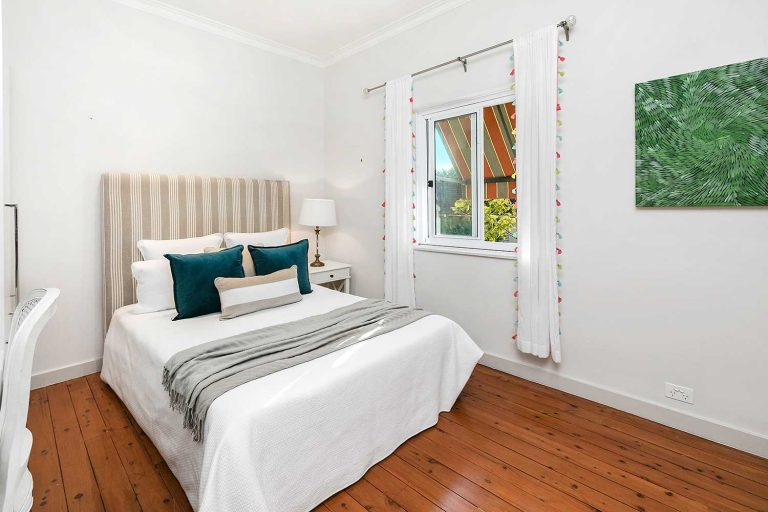 The guest bedroom in a Mosman terrace renovated by Diamond and Lambert Builders.