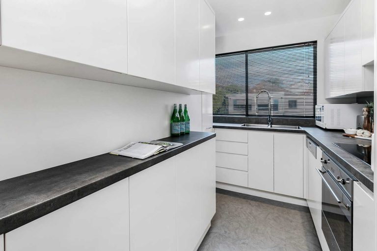 The renovation by Diamond and Lambert Builders included a new galley-style kitchen.