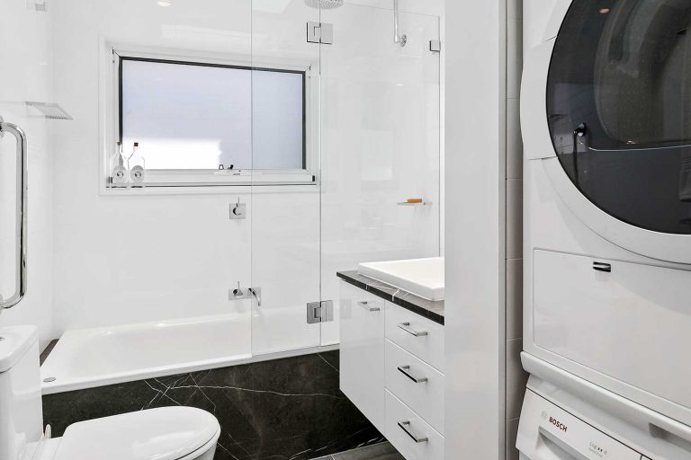 The updated bathroom and laundry of a renovated terrace in Mosman.