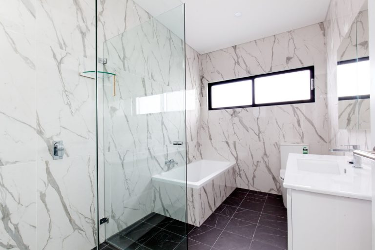 The bathrooms in both residences of this new Northern Beaches duplex are tiled from floor to ceiling for dramatic effect.