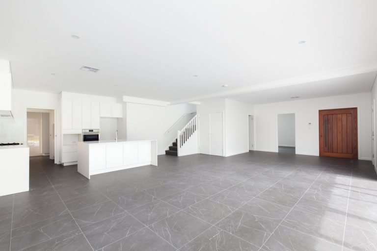 The tiling throughout the ground floors of this Northern Beaches duplex extends to the outdoor entertainment area.