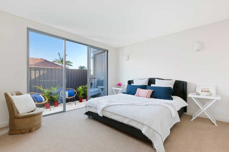 The main bedroom of a home in Collaroy extended and renovated by Diamond and Lambert Builders.