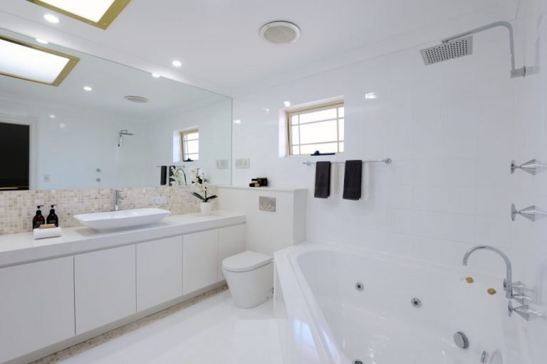 A large spa bath is a feature of the Chatswood bathroom renovated by Diamond and Lambert Builders.