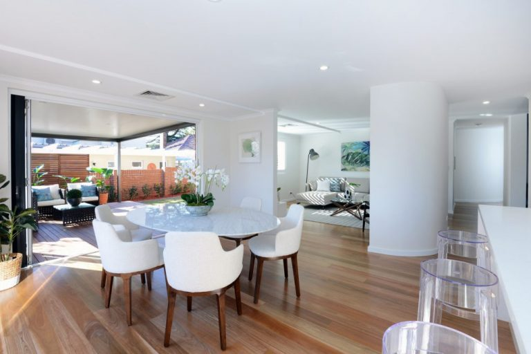 The beautiful tones of the new timber floor in the Chatswood home are set against the sleek whites of the interior.