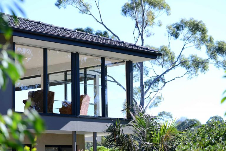 The floor-to-ceiling windows on this Naremburn home optimise the views to its bushland setting.